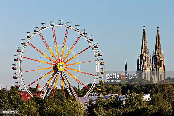 Germany, Bavaria, Regensburg, View of ferris wheel with cathedral