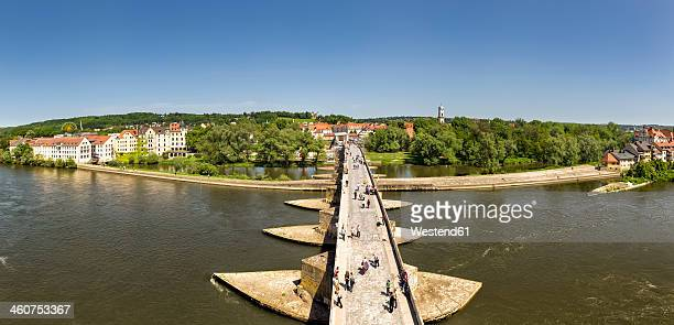 germany, bavaria, regensburg, view of stadtamhof, old stone bridge crossing danube river with danube island - regensburg stock photos and pictures