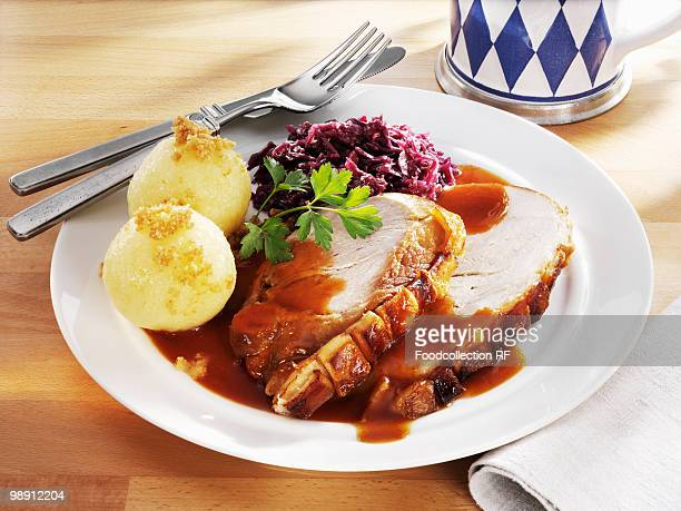 Germany, Bavaria, Roast pork with potato dumplings and red cabbage