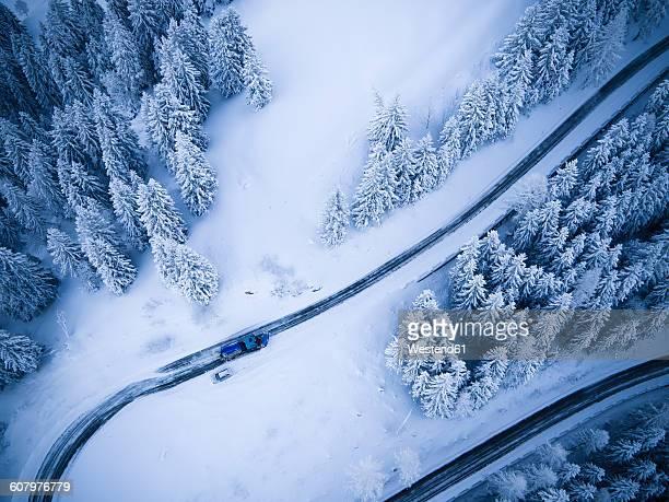 germany, bavaria, rossfeldstrasse, alpine road and snowplough in winter - schneefahrzeug stock-fotos und bilder