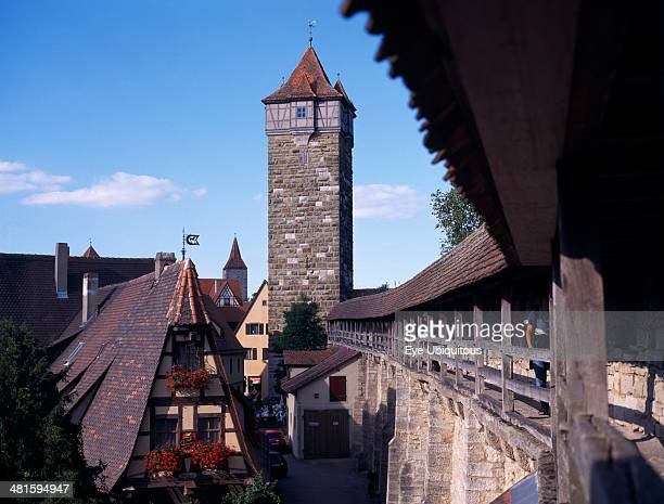 Germany Bavaria Rothenburg View from the town walls under covered walkway toward tower and gable