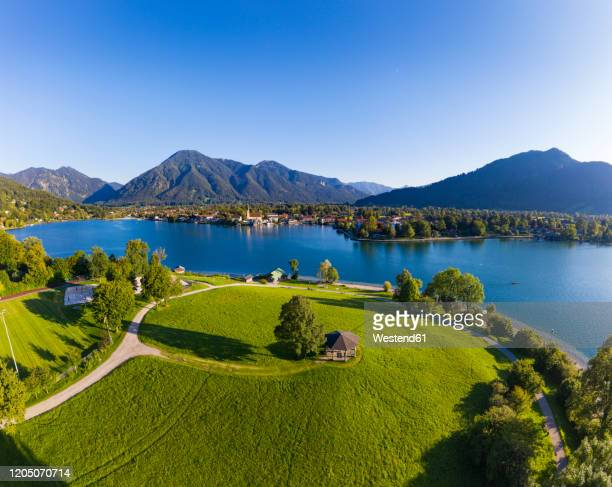 germany, bavaria, rottach-egern, aerial view of lakeshore gazebo with town and bavarian alps in background - tegernsee stock pictures, royalty-free photos & images