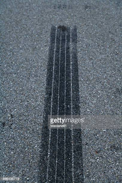 Germany, Bavaria, Skidmarks on tarmac