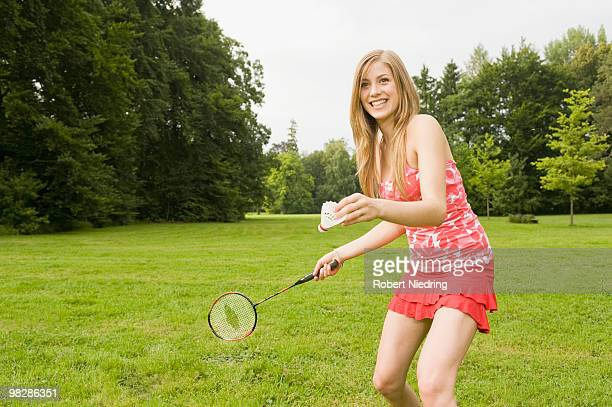 Germany, Bavaria, Starnberger See, Teenage girl (16-17) playing badminton, smiling