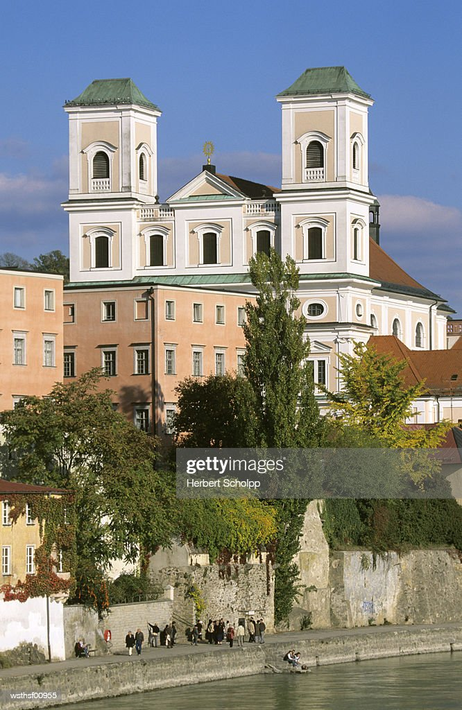 Germany, Bavaria, Studienkirche in Passau, in front of Danube river : Stock Photo