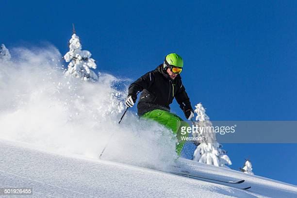 Germany, Bavaria, Sudelfeld, Skier in deep powder snow