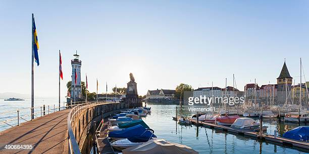 germany, bavaria, swabia, lake constance, harbour with the old town and mangturm and light house - bodensee stock-fotos und bilder
