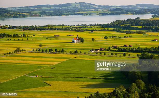Germany, Bavaria, Swabia, Schwangau, Allgaeu, East Allgaeu, View to pilgrimage church St. Coloman and Lake Forggensee