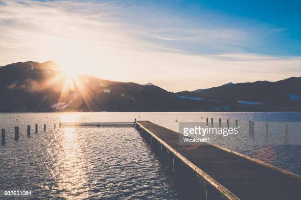 germany, bavaria, tegernsee, boardwalk at sunset - tegernsee stock pictures, royalty-free photos & images