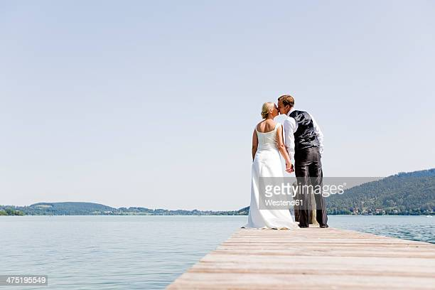 Germany, Bavaria, Tegernsee, Wedding couple standing on jetty