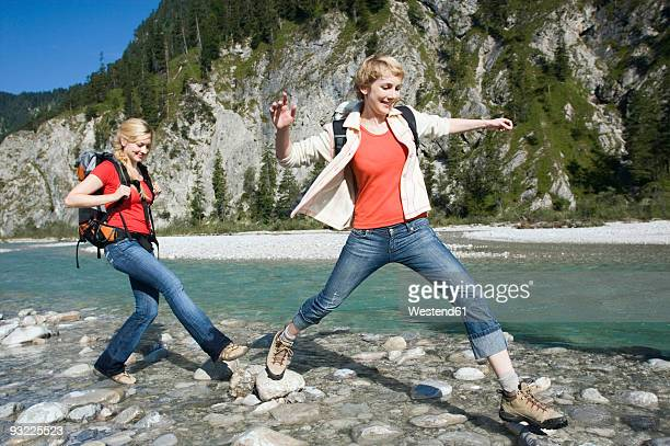 germany, bavaria, tölzer land, girlfriends hiking - stepping stock pictures, royalty-free photos & images