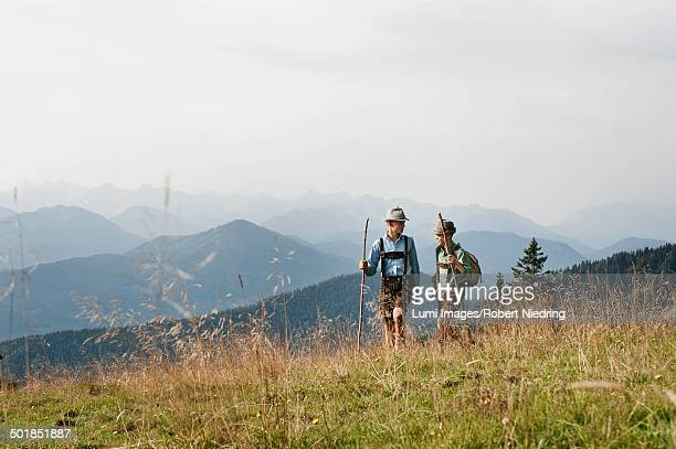 Germany, Bavaria, Two boys hiking in mountains