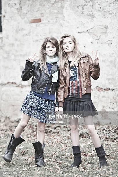 Germany, Bavaria, Two girls standing on backstreet