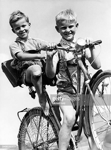 Two schollboys on a bicycle about 1955