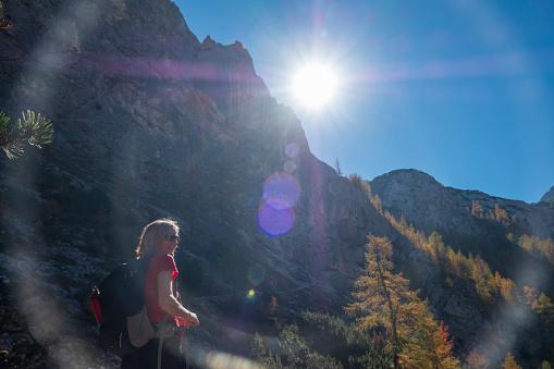 Germany, Bavaria, Upper Bavaria, Berchtesgadener Land, Berchtesgaden National Park, female hiker against the sun - gettyimageskorea