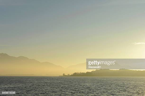 Germany, Bavaria, Upper Bavaria, Lake Chiemsee with Kampenwand, Laubenstein and Hochries in the evening