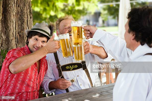Germany, Bavaria, Upper Bavaria, Men in beer garden