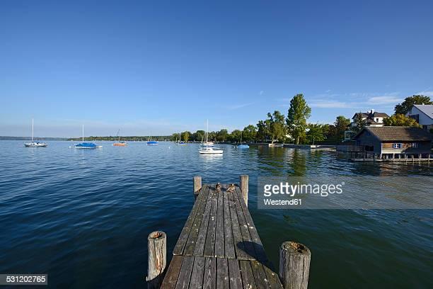 Germany, Bavaria, Upper Bavaria, near Herrsching, Ammersee lake and wooden jetty