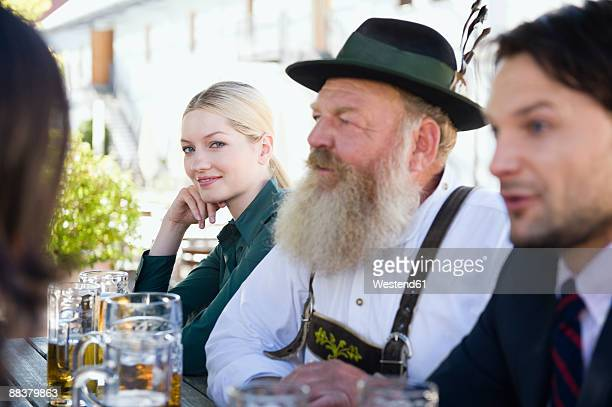 Germany, Bavaria, Upper Bavaria, People in beer garden