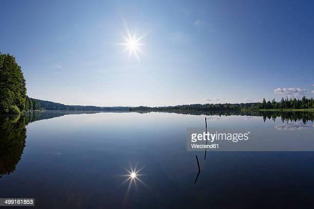 Germany, Bavaria, Upper Bavaria, Sachsenkam, Kirchsee lake against the sun