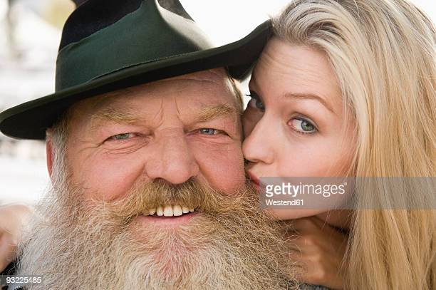 germany, bavaria, upper bavaria, senior man and young woman, smiling, portrait, close-up - old man young woman stock photos and pictures
