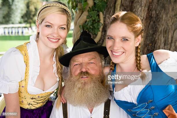 Germany, Bavaria, Upper Bavaria, Senior man with two women, smiling, portrait