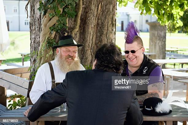 Germany, Bavaria, Upper Bavaria, three men in beer garden
