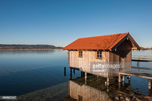 Germany, Bavaria, Upper Bavaria, View of boathouse at Lake Kochelsee