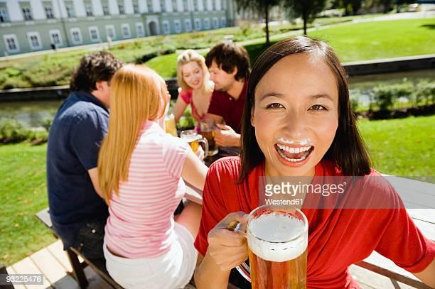 Germany, Bavaria, Upper Bavaria, Young people in beer garden