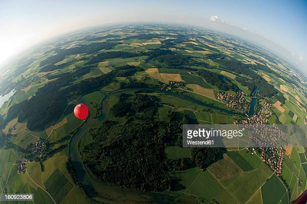 germany, bavaria, view of hot air balloon over pasture landscape - fish eye foto e immagini stock