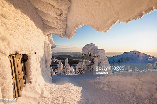 Germany, Bavaria, View of snow covered mountain hut at Bavarian Forest
