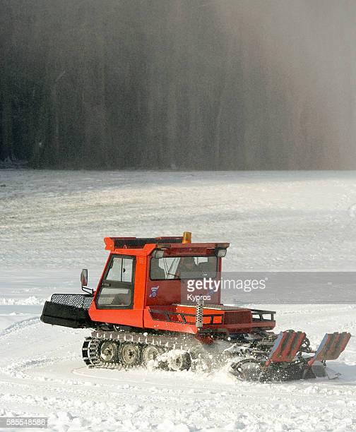germany, bavaria, view of snowcat tracked vehicle or piste machine on snow covered field - schneefahrzeug stock-fotos und bilder