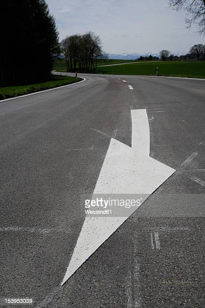 Germany, Bavaria, View of white arrow sign marking on road