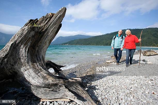 Germany, Bavaria, Walchensee, Senior couple hiking on lakeshore