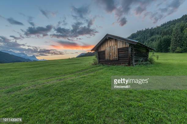 Germany, Bavaria, Werdenfelser Land, hay barn at sunrise