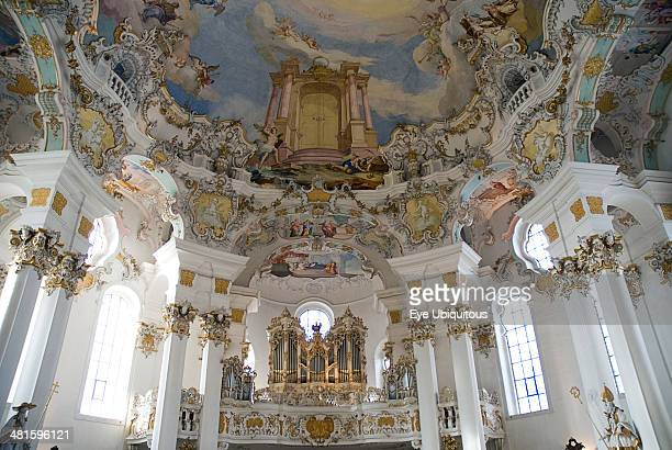 Germany Bavaria Wieskirche Baroque church interior view of the church organ and frescoes on ceiling depicting Door of Heaven Paradise