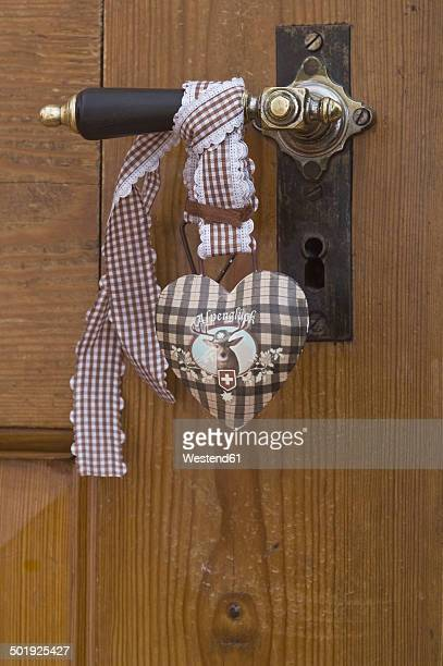 Germany, Bavaria, Wooden door with brown heart, Alpenglueck