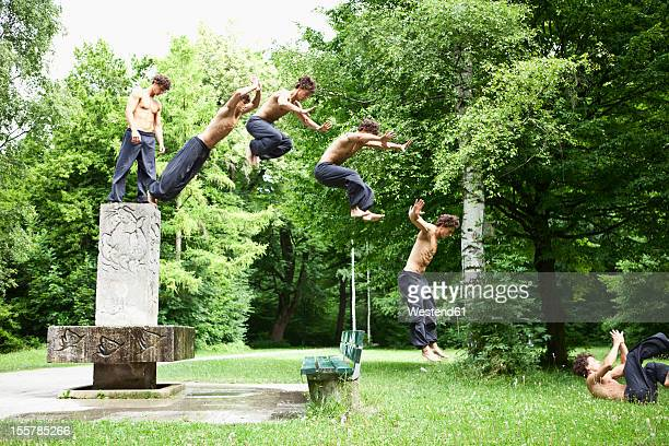 germany, bavaria, young man jumping from fountain - multiple exposure sport stock pictures, royalty-free photos & images