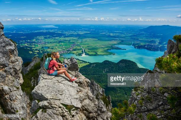 germany, bavaria, young woman taking a break after running in the mountains - bavarian alps stock pictures, royalty-free photos & images