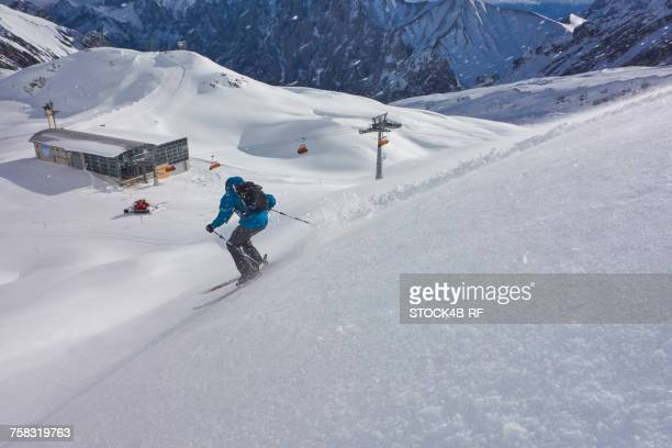'Germany, Bavaria, Zugspitz Arena, man skiing off-piste'