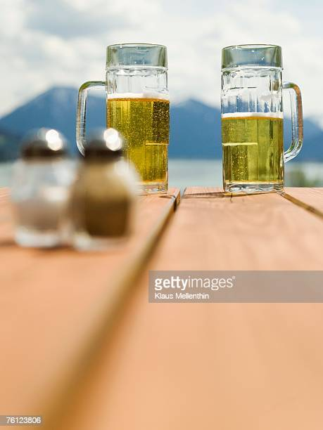 germany, bavaria,tegernsee, beer glasses on table - tegernsee photos et images de collection