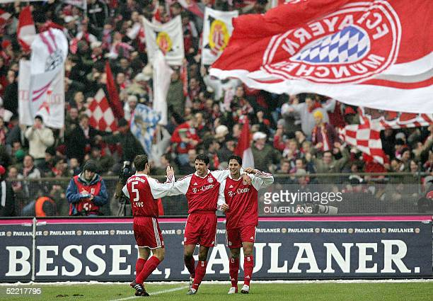 Bayern Munich's players Robert Kovac , Roy Makaay and Claudio Pizarro celebrate their fourth goal against Dortmund 19 February 2005 at Munich's...