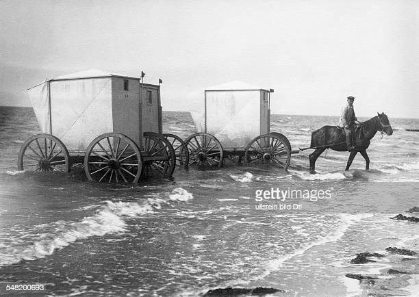 Germany beach life seaside resort at the north sea coast bathing machines