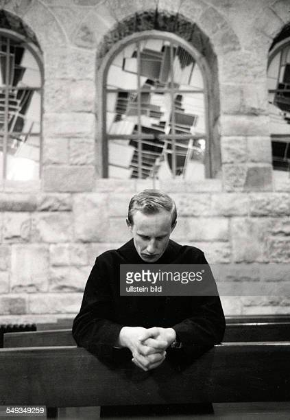 Germany Benedictine monk praying in the church of Muensterschwarach