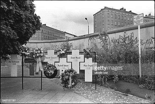 Germany Berlin memorial crosses in commemoration for the victims of the Berlin Wall at Bernauer Straße in the district of Wedding