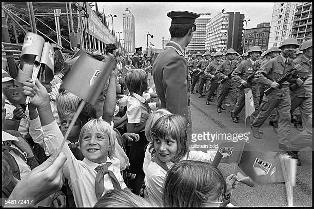 Germany Berlin GDR celebrating the 25th anniversary of the building of the wall Members of the Combat Group of the Working Class demonstrating in the...