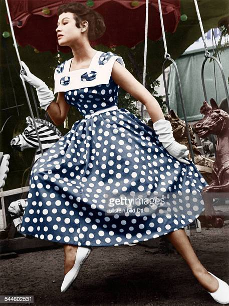 Germany Berlin A young woman wearing a summer dress with white dots and a petticoatphoto by Hilla Korn 1955Digitally colorized Original image no...