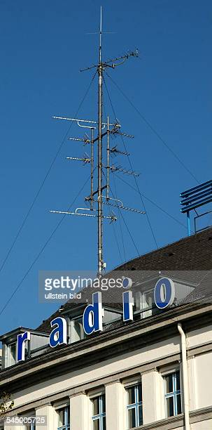 aerial mast and emblem of the radio station Deutschlandradio on the roof of the RIAS broadcasting centre