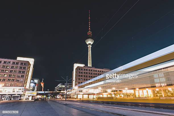 Germany, Berlin, Alexanderplatz and TV Tower at night, light trail of tramway