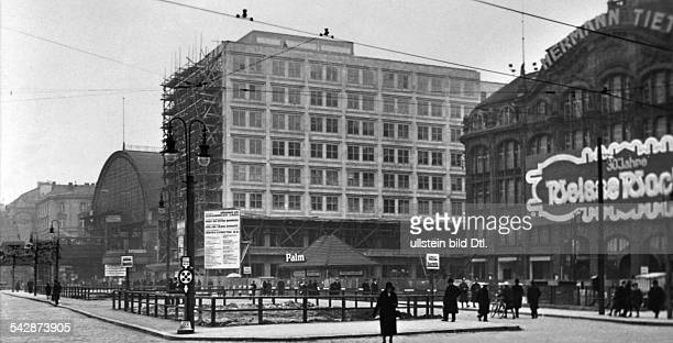 Germany Berlin Alexanderplatz SBahn station the business building Berolinahaus under construction and the department store Hermann Tietz around 1930